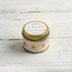 A mini tin candle with get well soon on the led and white and yellow daisy flowers all the way round