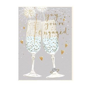 A lovely card with an image of two champagne glasses with sparklers in them and the words Yay You're Engaged printed and embossed in gold effect.