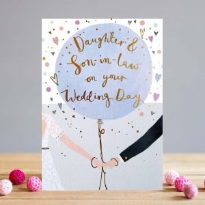 A lovely card with a bride and groom holding hands and holding a large balloon. Inside the balloon the words Daughter and Son in Law on your Wedding day are printed on it.