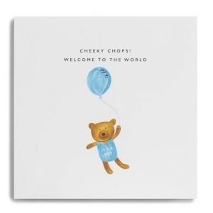 A new baby boy card with a little cute teddy in a blue babygrow with Its a boy. The teddy is holding a blue balloon and the words across the top of the card say Cheeky Chops! Welcome to the world
