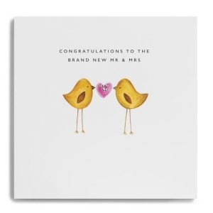 A wedding card for the brand new mr and mrs with two cute love birds holding a heart.