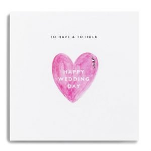A wedding card with a big pink heart with happy wedding day written inside it and to have and to hold across the top