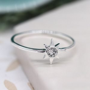 Silver Star And Crystal Ring. A silver ring with a celestial star set with a clear crystal in the centre