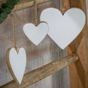 White enamel and wood hanging hearts. A white enamel and mango wood hanging heart in a choice of three sizes.