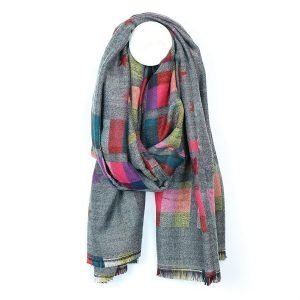 A large grey and pink scarf with a reversible check and star jacquard pattern