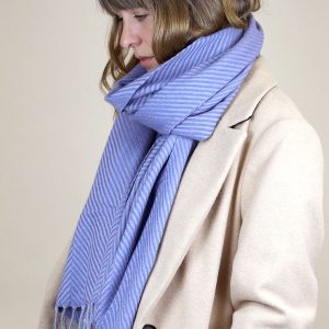 A denim blue and soft grey scarf with a chevron design and a grey fringe