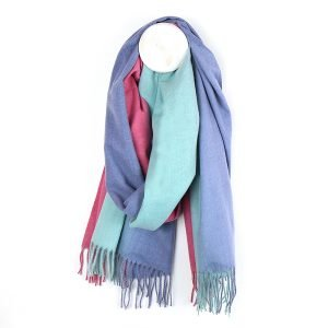 A bright pink and blue scarf with an ombre print