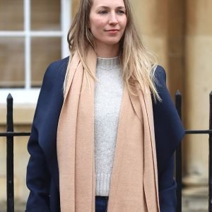 A plain camel scarf with a fringe