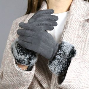 A pair of grey faux suede gloves with a two tone fur wrist trim