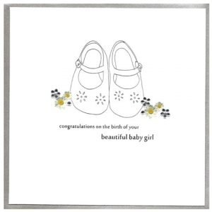 A lovely new baby girl card with cute baby shoe design.