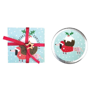 A cute little tin of lip balm which is presented in a little cardboard sleeve with an image of a dachshund with a christmas pudding on its back.