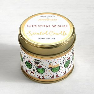 A lovely Wintertime tin candle with an image of little sprout people around the side of the tin. The Words Christmas wishes are printed on the top of the tin.