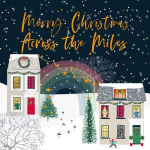 A large across the miles Christmas card with two houses and a rainbow connecting them