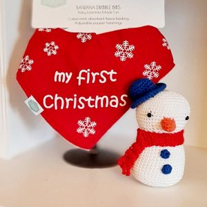 A red soft absorbent cotton bandana dribble bib with white snowflakes and my first christmas
