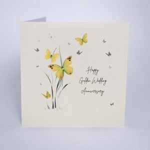 A beautiful card from Five Dollar Shake with an image of grass and butterflies and the words Happy Golden Wedding Anniversary are printed on the card.