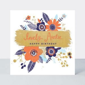 A lovely white card with a floral design with a beige panel in the centre of it The words Lovely Auntie Happy Birthday