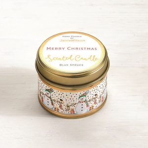 A sweet Blue Spruce mini candle with an image of little snowmen printed around the side of the tin. The words Merry Christmas are printed on the label on the top of the tin.