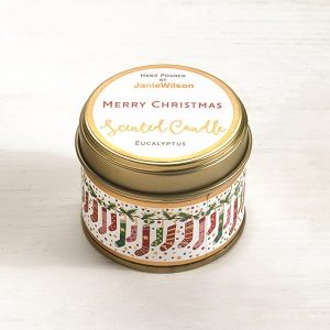 A sweet Eucalyptus mini candle with an image of little Christmas stockings printed around the side of the tin. The words Merry Christmas are printed on the label on the top of the tin.