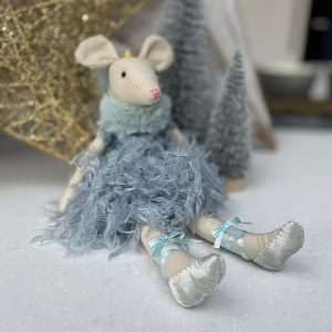 A cute cotton mouse with a pink nose and cute round ears. The mouse is wearing a lovely plae blue dress which is feathered at the skirt.