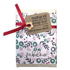 A lovely soap in a flowered paper with a silk ribbon and wooden flower The word Fabulous is printed on the paper wrapper,