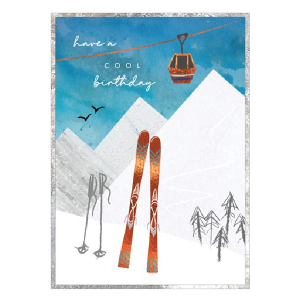 A lovely birthday card to give to someone who loves skiing. The image is of mountains a ski lift and some skis and poles propped up on it.