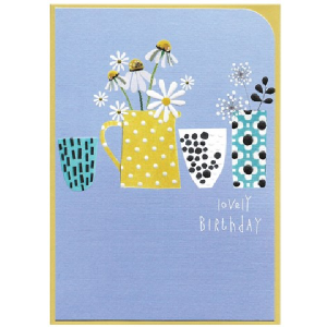 A gorgeous floral Lovely Birthday card with daisies and sunflowers on it.